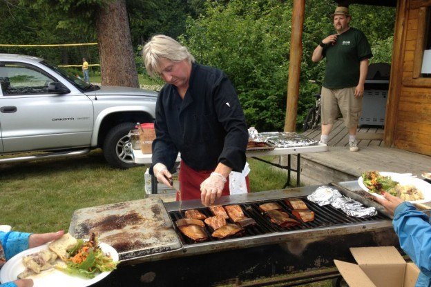 Guests enjoying BBQ food after a paddle down the river of golden dreams